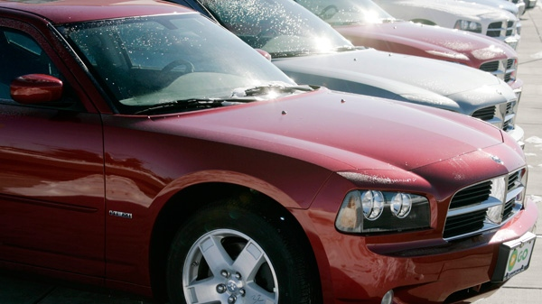 Dodge Charger sedans sit on the lot of a Dodge agency in the south Denver suburb of Centennial, Colo.(AP Photo/David Zalubowski)