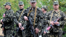 Ukrainian troops stand guard in eastern Ukraine