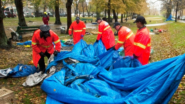 Police remove tents at the Occupy Nova Scotia camp in Halifax on Friday, Nov. 11, 2011. (Andrew Vaughan / THE CANADIAN PRESS)