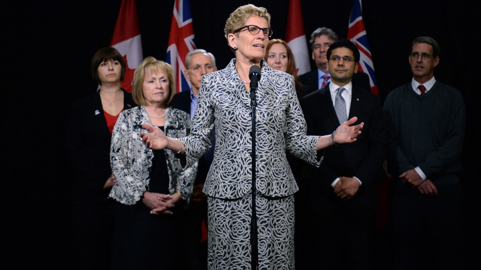 Ontario Liberal leader Kathleen Wynne is backed by Liberal candidates from the Ottawa area as she speaks to reporters in Ottawa on Thursday, May 8, 2014. (Sean Kilpatrick / THE CANADIAN PRESS)