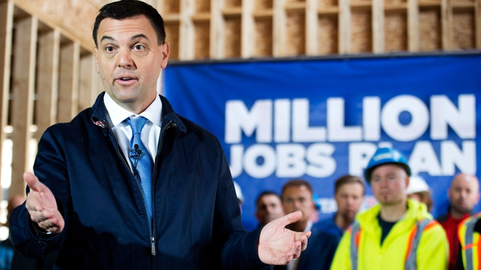 Ontario PC leader Tim Hudak speaks with trade workers at a new housing development during a campaign stop promising to create 200,000 new skilled trade jobs in Vaughan, Ont., on Thursday, May 8, 2014. (Nathan Denette / THE CANADIAN PRESS)