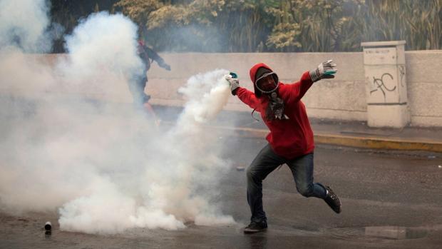 Demonstrator throws teargas canister in Venezuela