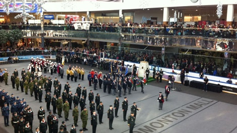 Edmontonians attend a Remembrance Day ceremony at West Edmonton Mall's Ice Palace on Friday, Nov. 11, 2011.