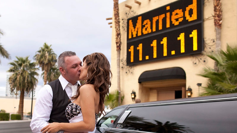 Gary, left, and Cindy Prest of Seattle, Wash., kiss in front of the Viva Las Vegas Wedding Chapel in Las Vegas after getting married, Friday, Nov. 11, 2011. (AP / Julie Jacobson)