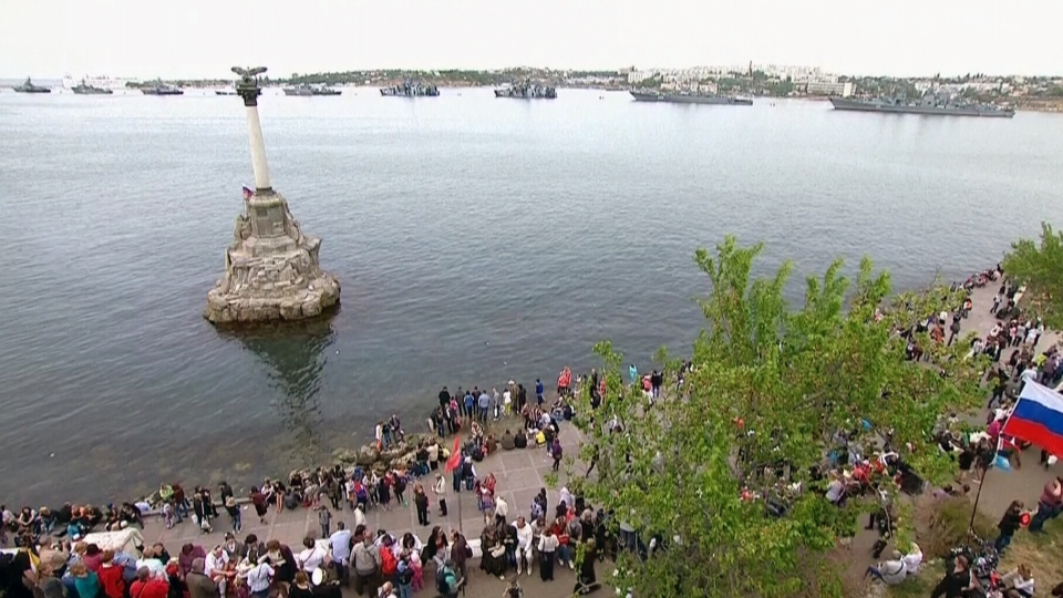 Russian naval vessels sit in the Crimean port of Sevastopol, Friday, May 9, 2014.