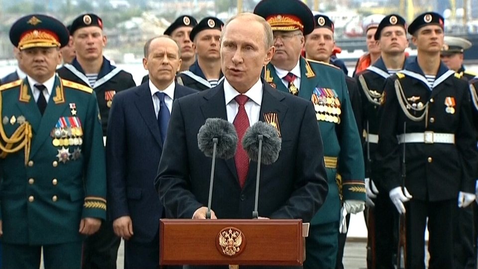 Russian President Vladimir Putin speaks to gathered crowds in Crimea, Friday, May 9, 2014.