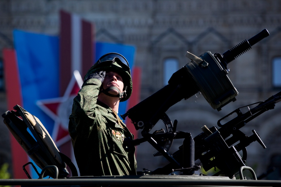 A Russian soldier salutes during the Victory Day parade in the Red Square in Moscow, Russia, Friday, May 9, 2014. (AP / Pavel Golovkin)