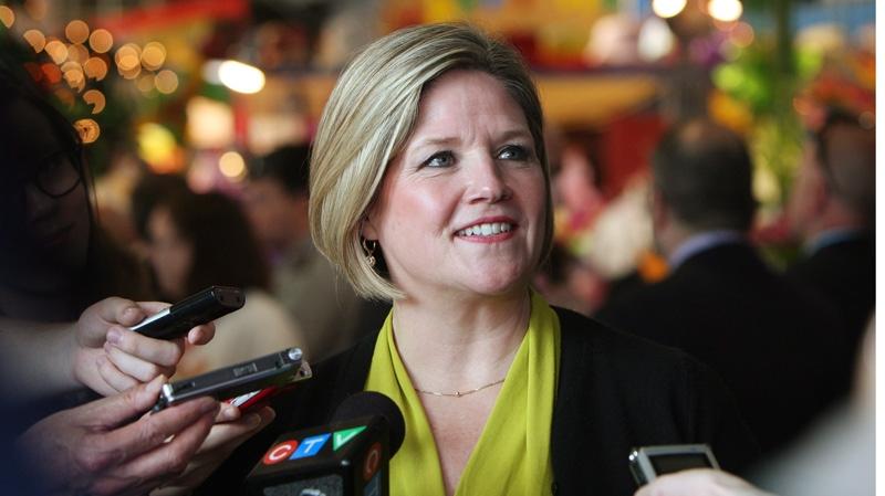 Ontario NDP leader Andrea Horwath answers questions from the media at the Covent Gardent Market as she campaigns in downtown London, Ont., Thursday, May 8, 2014. (Dave Chidley / THE CANADIAN PRESS)