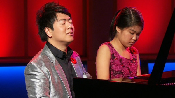 Pianist Lang Lang, left, performs on CTV's Canada AM on Friday, Nov. 11, 2011.