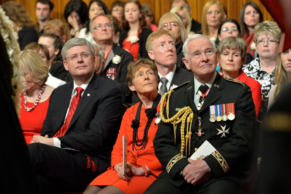 From right, Governor General David Johnston, his wife Sharon, and Prime Minister Stephen Harper attend a National Day of Honour ceremony in Ottawa on Friday May 9, 2014. (Adrian Wyld / THE CANADIAN PRESS)