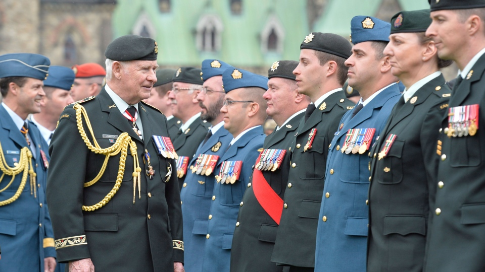 Governor General David Johnston inspects an honour guard on Parliament Hill in Ottawa on Friday, May 9, 2014 during a ceremony to pay respects to the veterans and the dead of the Afghanistan war. (Adrian Wyld / THE CANADIAN PRESS)