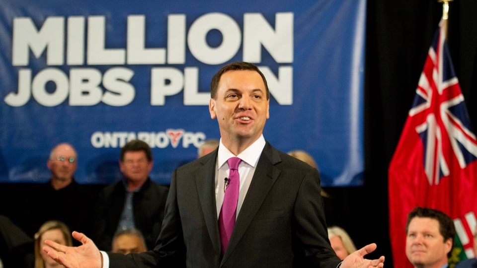 Ontario PC leader Tim Hudak speaks at a breakfast town hall meeting about balancing the budget in two year if elected during a campaign stop in Barrie, Ont., on Friday, May 9, 2014. (Nathan Denette / THE CANADIAN PRESS)