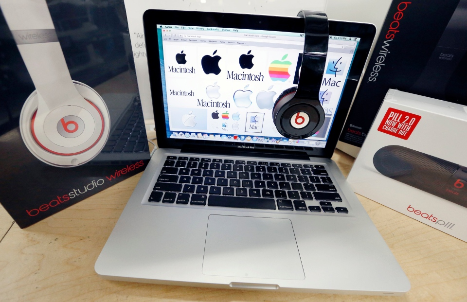 Beats Audio equipment is arranged for a photo next to an Apple laptop at Best Buy in Boston, Friday, May 9, 2014. (AP / Michael Dwyer)