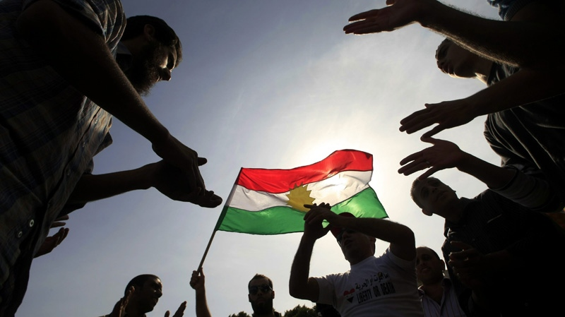 Protesters chant anti-Syrian regime slogans as they wave a Kurdish flag outside the Arab League headquarters in Cairo, Egypt, Wednesday, Nov. 9, 2011. (AP Photo/Amr Nabil)