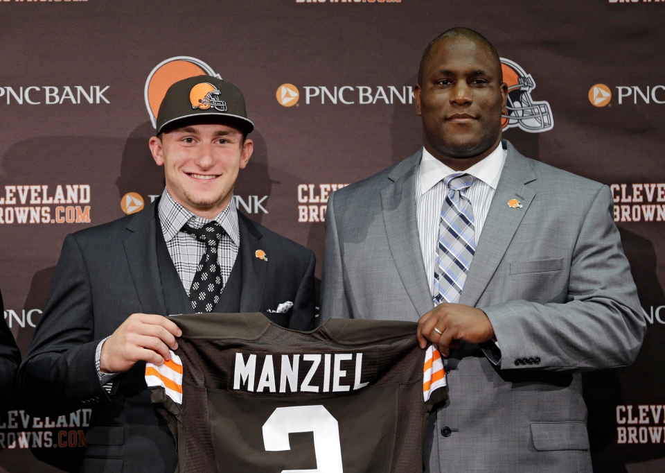 Cleveland Browns quarterback Johnny Manziel, from Texas A&M, holds his new jersey with general manager Ray Farmer at the NFL football team's facility in Berea, Ohio Friday, May 9, 2014. The Browns selected Manziel with the 22nd overall pick in Thursday's NFL draft. (AP Photo/Tony Dejak)