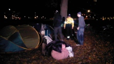 Officers forced the removal of two tents outside Queen's Park which set up earlier Saturday as an offshoot of the larger Occupy Toronto movement.