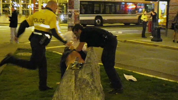In this image taken from YouTube, Const. Chris Bowser is shown during an altercation with Tyler Archer in Victoria on Saturday, March 21, 2010.