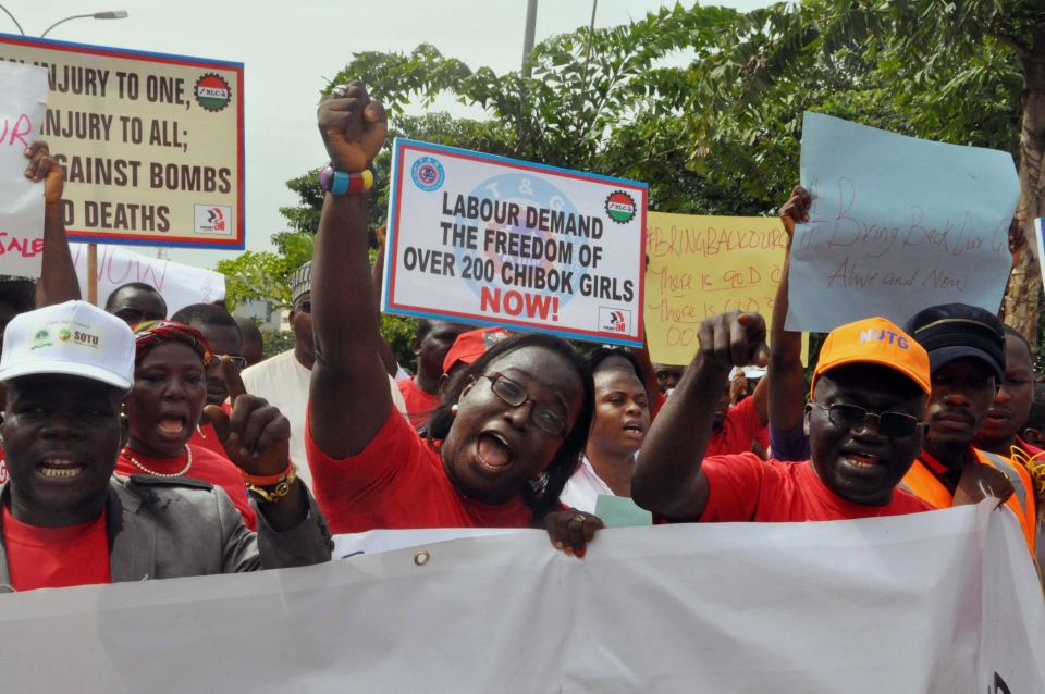 People attend a demonstration calling on the government to rescue the kidnapped school girls from the Chibok government secondary school, outside the defense headquarters in Abuja, Nigeria, Tuesday May 6, 2014.  (AP / Gbenga Olamikan)