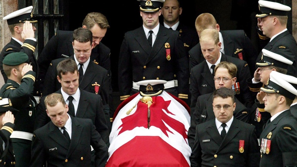 Pallbearers carry the coffin of Lieut. Chris Saunders from St. Andrew's Church in Halifax Wednesday, Oct. 13, 2004. Saunders died after a fire on the Victoria-class submarine HMCS Chicoutimi off the coast of Ireland. (Andrew Vaughan / THE CANADIAN PRESS)