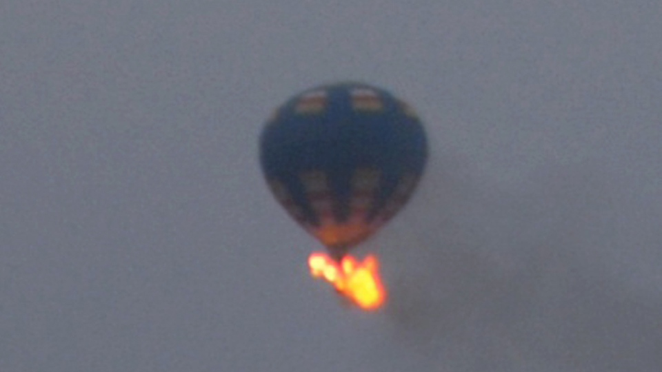 This photo provided by Nancy Johnson shows what authorities say is a hot-air balloon that was believed to have caught fire and crashed in Virginia, Friday, May 9, 2014. (AP / Nancy Johnson)
