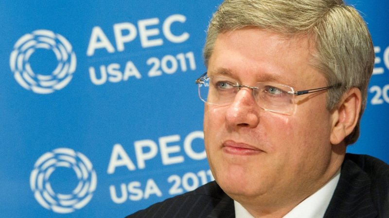 Prime Minister Stephen Harper takes part in a briefing during the 2011 APEC Summit in Honolulu, Hawaii on Saturday, Nov. 12, 2011. (Sean Kilpatrick / THE CANADIAN PRESS)