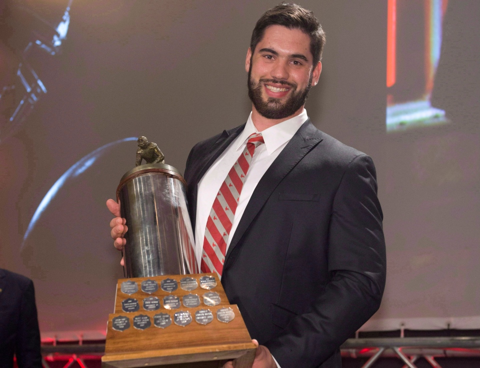Laurent Duvernay-Tardif of the McGill University Redmen receives the J.P. Metras Trophy as the Outstanding Lineman during Vanier Cup celebrations Thursday, November 21, 2013 in Quebec City. THE CANADIAN PRESS/Jacques Boissinot