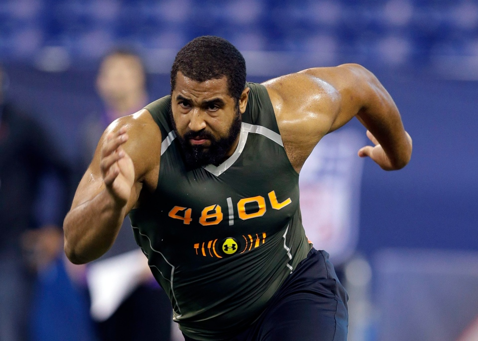 In this Feb. 22, 2014, file photo, Penn State offensive lineman John Urschel runs a drill at the NFL football scouting combine in Indianapolis. (AP Photo/Michael Conroy, File)