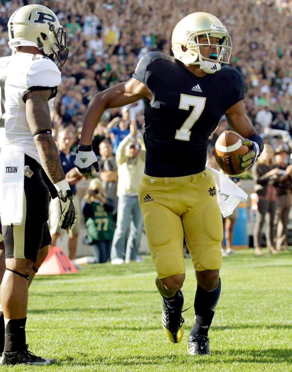 In this Sept. 8, 2012, file photo, Notre Dame wide receiver T.J. Jones (7) celebrates a touchdown during the second half of an NCAA college football game in South Bend, Ind. (AP Photo/Michael Conroy, File)