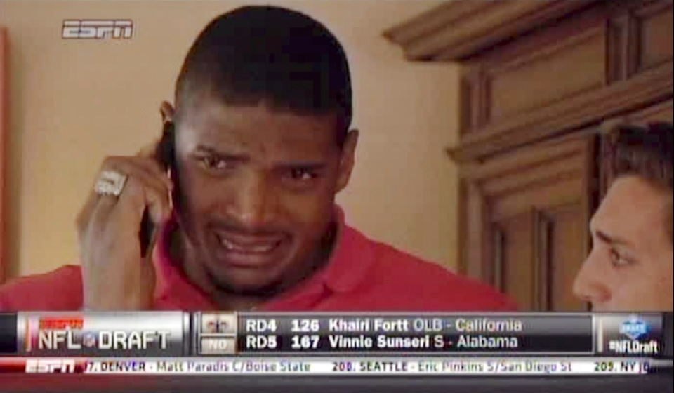 In this image taken from video, Missouri defensive end Michael Sam cries as he talks on a mobile phone at a draft party in San Diego, after he was selected in the seventh round, 249th overall, by the St. Louis Rams in the NFL draft Saturday, May 10, 2014. The Southeastern Conference defensive player of the year last season came out as gay in media interviews this year. (AP Photo/ESPN)