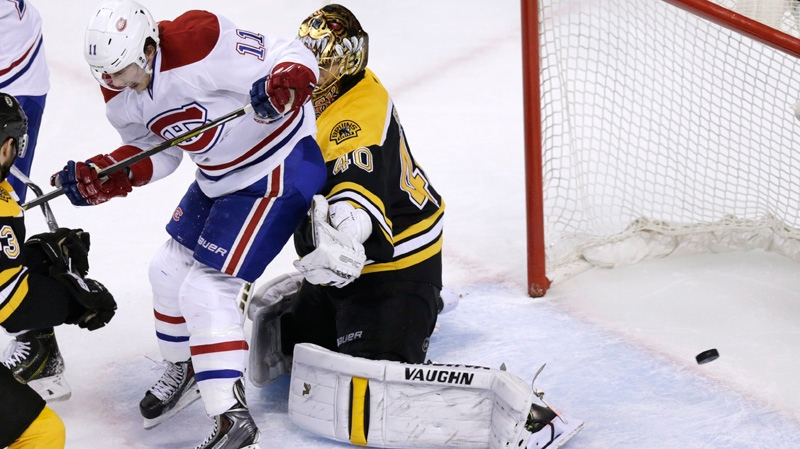 Montreal Canadiens right wing Brendan Gallagher (11) deflects the puck past Boston Bruins goalie Tuukka Rask (40) for a goal during the second period of Game 5 in the second-round of the Stanley Cup hockey playoff series in Boston, Saturday, May 10, 2014. (AP Photo/Charles Krupa)