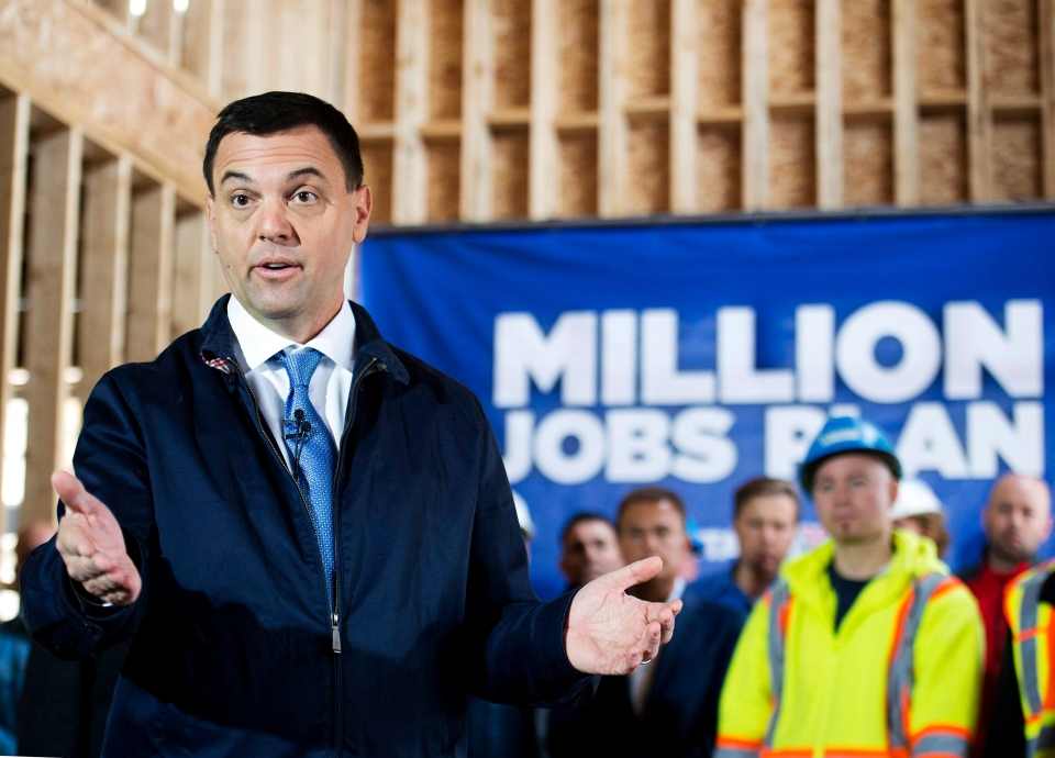 Ontario PC leader Tim Hudak speaks with trade workers at a hew housing development during a campaign stop promising to create 200,000 new skilled trade jobs in Vaughan, Ont., on Thursday, May 8, 2014. (Canadian Press / Nathan Denette)