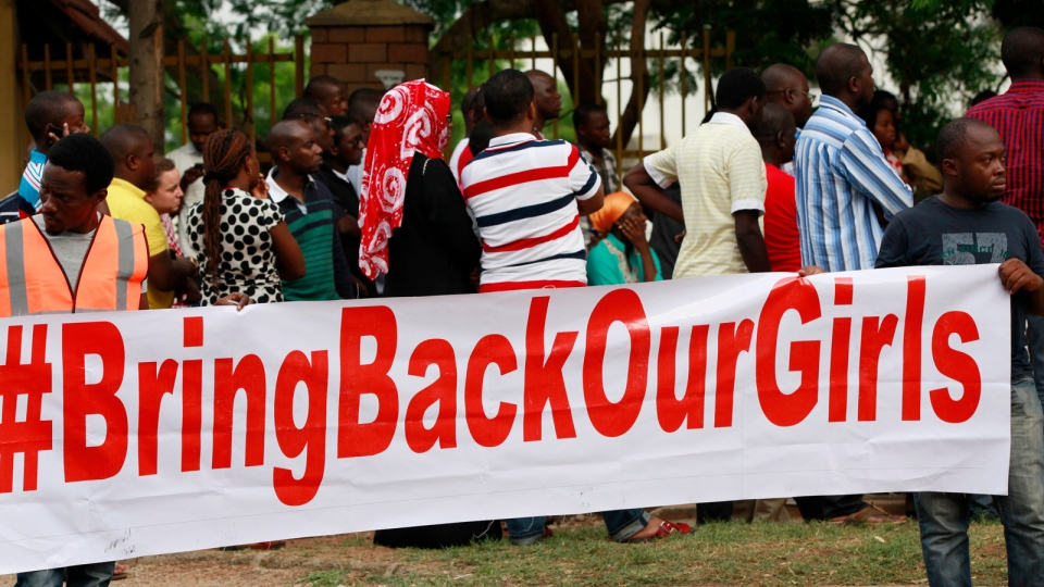 People attend a rally calling on the Government to rescue the school girls kidnapped from the Chibok Government secondary school, in Abuja, Nigeria, Saturday May 10, 2014. (AP / Sunday Alamba)