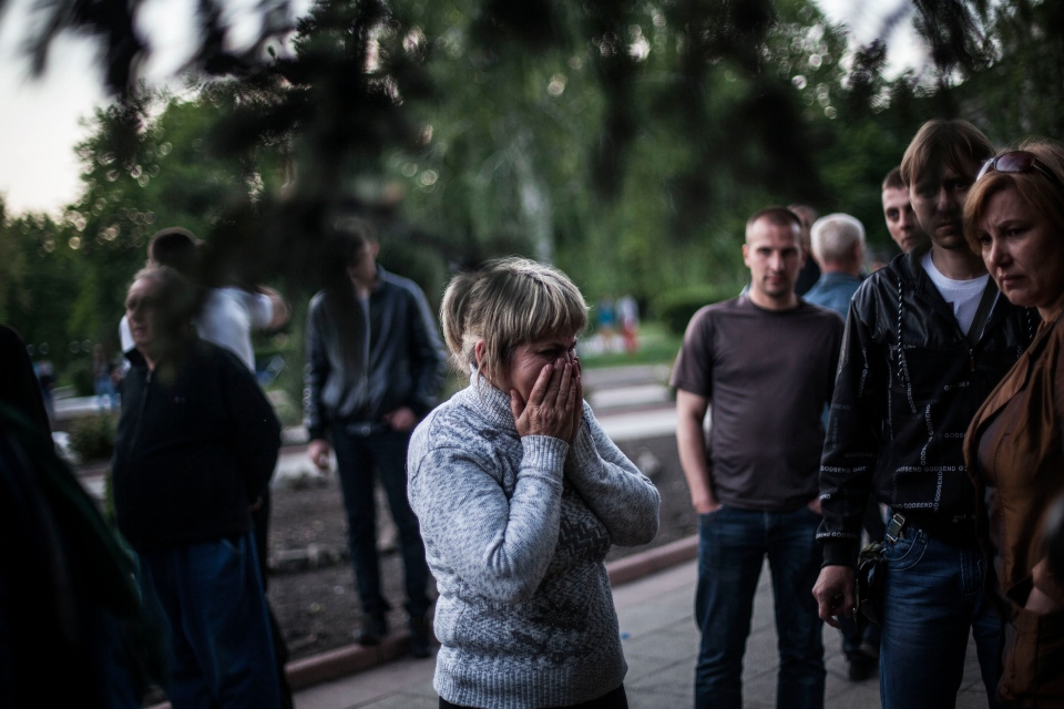 A woman reacts after Ukrainian national guardsmen opened fire on a crowd outside a town hall in Krasnoarmeisk, about 30 kilometers from the regional capital of Donetsk, Ukraine, on Sunday, May 11, 2014. (AP / Manu Brabo)