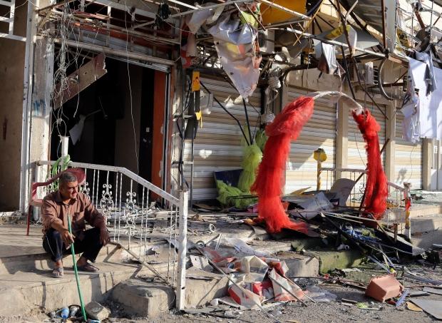 Shopkeeper outside Iraqi neighbourhood