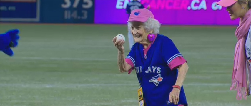 Kitty Cohen, 101, is seen winding up to throw the ceremonial first pitch at the Blue Jays' Mother's Day game against the Angels on May 11, 2014.