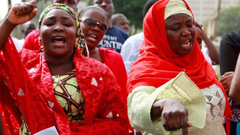 Women shout slogans during a rally calling on the Government to rescue the school girls kidnapped from the Chibok Government secondary school in Abuja, Nigeria, Sunday May 11, 2014. (Sunday Alamba)