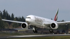 Boeing Co. 777, owned by Emirates, makes a landing in Everett, Wash.