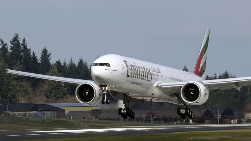 A Boeing Co. 777, owned by Emirates, makes a landing in Everett, Wash., Feb. 8, 2010. (AP / Ted S. Warren)