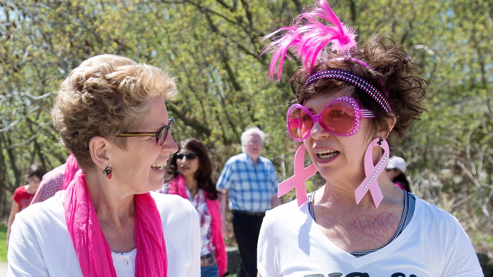 Ontario Liberal Leader Kathleen Wynne, left, speaks with a fellow participant in the Breast Cancer Society of Canada's Mother's Day Walk in Mississauga, Ont. on Sunday, May 11, 2014. (Darren Calabrese / THE CANADIAN PRESS)