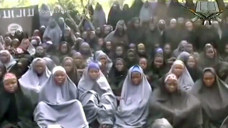A number of the kidnapped Nigerian girls are seen in a rural location, wearing full-length abayas and praying in a new video released on Monday.