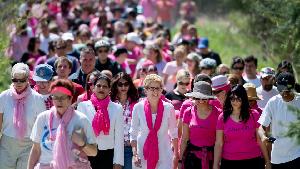 Ontario Liberal Leader Kathleen Wynne, centre, participates in the Breast Cancer Society of Canada's Mother's Day Walk in Mississauga, Ont. on Sunday, May 11, 2014. (Darren Calabrese / THE CANADIAN PRESS)