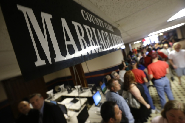 Arkansas gay couples line up for marriage licenses