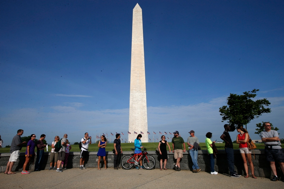 Visitors line up for tickets at the Washington Monument in Washington, Monday, May 12, 2014. (AP)