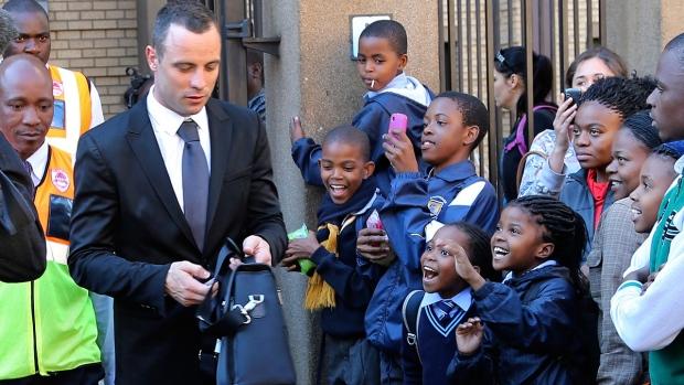 Children react as Oscar Pistorius leaves court
