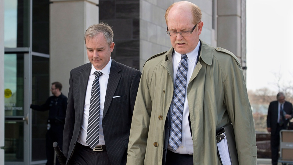 Dennis Oland, left, charged with second-degree murder in the death of his father, walks with Bill Teed, the lawyer for the Oland family, from his preliminary hearing at the Law Courts in Saint John, N.B. on Monday, May 12, 2014. (Andrew Vaughan / THE CANADIAN PRESS)