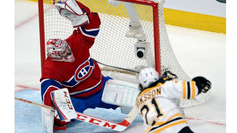 Montreal Canadiens goalie Carey Price (31) makes a save on Boston Bruins' Loui Eriksson (21) during first period NHL Stanley Cup playoff action Monday, May 12, 2014 in Montreal.THE CANADIAN PRESS/Ryan Remiorz