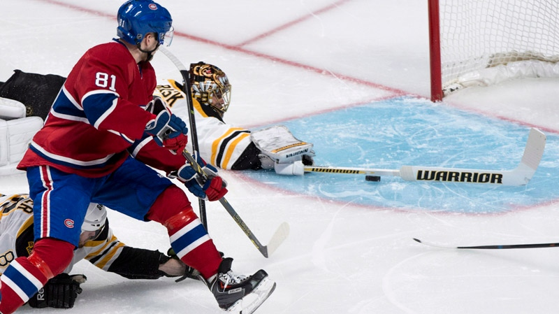 Montreal Canadiens' Lars Eller scores on Boston Bruins goalie Tuukka Rask during first period NHL playoff hockey action on Monday, May 12, 2014 in Montreal. THE CANADIAN PRESS/Paul Chiasson