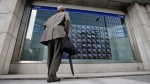 A man watches an electronic stock indicator of a securities firm in Tokyo, Tuesday, May 13, 2014. (AP / Shizuo Kambayashi)