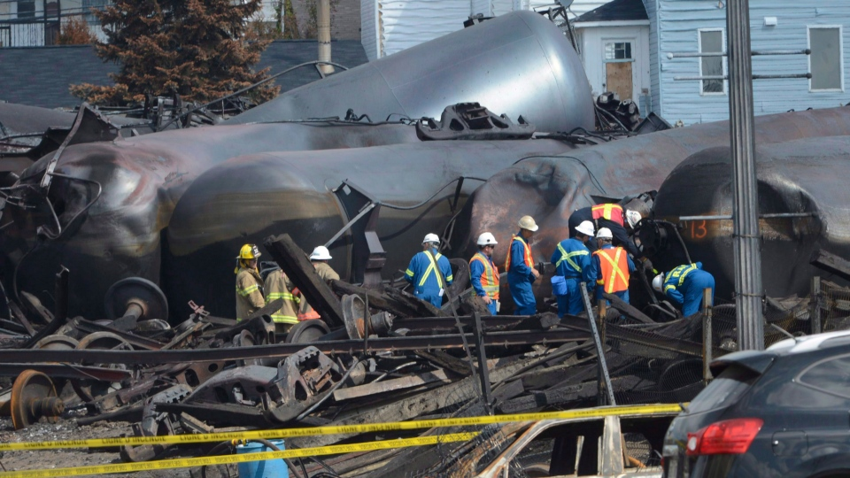 Emergency workers examine the aftermath of a train derailment and fire, in Lac-Megantic, Que., on July 6, 2013. (Ryan Remiorz / THE CANADIAN PRESS)