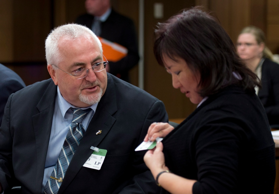 Carol Todd (right), the mother of Amanda Todd, speaks with Allan Hubley, the father of Jamie Hubley, as they wait to appear before the Commons justice committee discusses Bill C-13 on Tuesday, May 13, 2014 in Ottawa. (Adrian Wyld / THE CANADIAN PRESS)